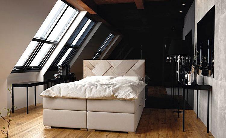 hotelowe łóżko w sypialni na poddaszu
