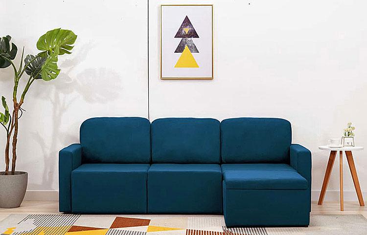 niebieska rozkładana sofa z funkcją spania