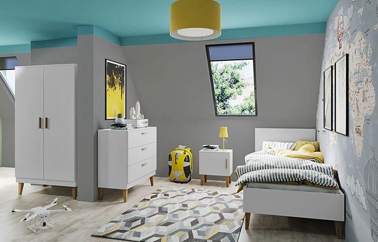 łóżko dla dziecka ustawione przy bocznej ścianie